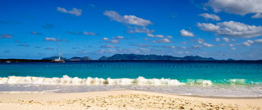 Cap Juluca Beach. Maundays Bay beach at Cap Juluca.  St. Martin in the background Royalty Free Stock Images
