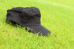Cap lay on the the green grass. Royalty Free Stock Images