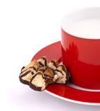 Cap of milk and cookies. Isolated on white Royalty Free Stock Photography