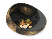 Cap with money. Isolated on white background Royalty Free Stock Photo