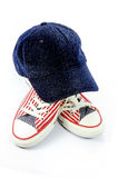 Cap and pair of shoes Royalty Free Stock Images