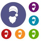 Cap with pompon of Santa Claus and beard icons set Stock Photos