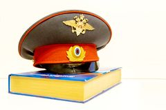 The cap of a Russian police officer is on the code of laws. Isolate royalty free stock photography