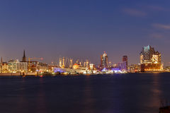 Cap San Diego and Elbphilharmonie Hamburg at blue hour. Panoramic view of the port of Hamburg at blue hour with museum ship Cap San Diego and Elbphilharmonie Stock Photography