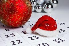 Cap of Santa Claus on the calendar Stock Image