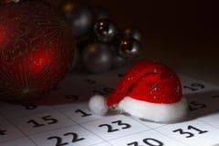 Cap of Santa Claus on the calendar Stock Images
