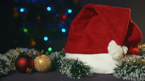 Cap of Santa Claus and Christmas toys stock video footage