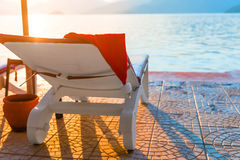 Cap of Santa Claus on a sun lounger Royalty Free Stock Images