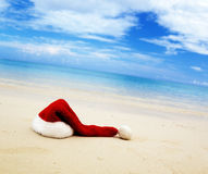 Cap of Santa and sea Stock Photography