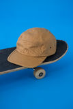 Cap on skateboard Royalty Free Stock Photo