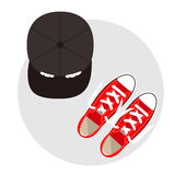 Cap and sneaker on the desk, top view, vector Royalty Free Stock Photos