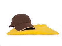 Cap and t shirt. Brown baseball cap and yellow t shirt Stock Photo