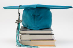 Cap, tassel and books royalty free stock photography