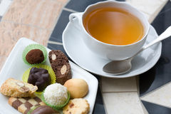 Cap of tea and sweets plate Royalty Free Stock Photography