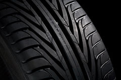 Cap of a tyre. Closeup of a new, black tyre. Black background Royalty Free Stock Photography
