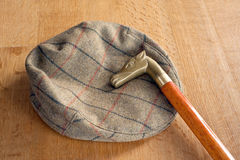Cap and walking-stick Royalty Free Stock Photos