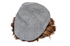 Cap and wig. A grey cap and a wig isolated on a white background Stock Images
