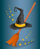 Cap wizard and witch broom. Cartoon style. Stock Image