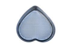 Capa antiadherente de la hornada de la cacerola en forma de corazón material del pan aislante Imagen de archivo