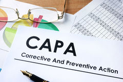 CAPA Corrective and Preventive action plans. Paper with words CAPA Corrective and Preventive action plans royalty free stock photos