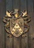 Capa de brazos en puerta vieja de madera del tablón Imagen de archivo libre de regalías