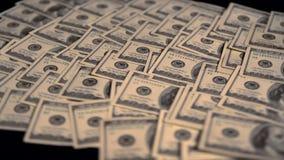 Capa de giro de 100 billetes de banco de USD en una tabla metrajes