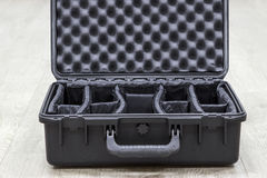 Capa de plástico vazia aberta para o equipamento da foto com divisores Fotos de Stock