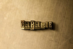 CAPABLE - close-up of grungy vintage typeset word on metal backdrop. Royalty free stock - 3D rendered stock image. Can be used for online banner ads and direct royalty free illustration
