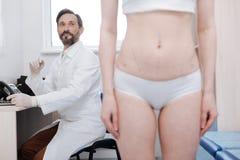 Capable successful plastic surgeon providing medical services Stock Photo