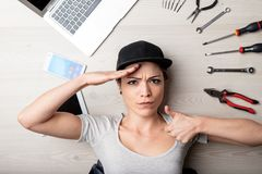 Capable young woman saluting the camera stock images
