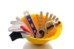 Capacete de segurança com ferramentas Fotografia de Stock