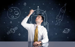 Capacete do desenho da pessoa das vendas e foguete de espaço Fotos de Stock