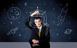 Capacete do desenho da pessoa das vendas e foguete de espaço Imagens de Stock