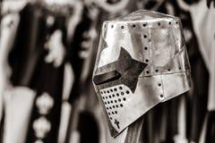 Capacete medieval do metal do cavaleiro no pico fotografia de stock royalty free