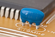 Capacitor. Motherboard mounted in front of an integrated chip stock images