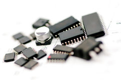 Capacitor Electronic Component. Capacitor on the middle of IC Group for do the new project Stock Photography