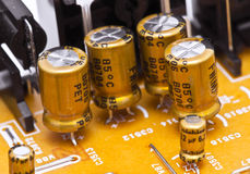 Capacitors. And electronic components mounted on a motherboard stock images