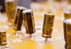 Capacitors. And electronic components mounted on a motherboard stock photo