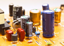 Capacitors. And electronic components mounted on a motherboard royalty free stock images