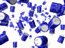 Capacitors abstraction. Blue 100uf capacitors floating in space on white background. Focus on one capacitor Stock Photo
