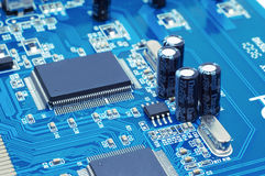 Capacitors And Chips On Microcircuit Royalty Free Stock Images