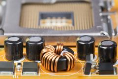Capacitors and chips on the board Royalty Free Stock Images