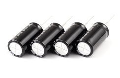 Capacitors. Electrolytic. Electrolytic capacitors on white background Stock Image