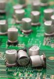 Capacitors na zieleni PCB Zdjęcie Royalty Free