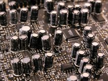 Capacitors on PCB. Of a sound card Royalty Free Stock Photo