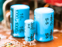 Capacitors. Resistors and other electronic components mounted on motherboard Stock Photo