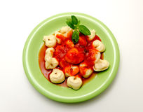 Capalleti. Pasta stuffed with tomato sauce Royalty Free Stock Photos