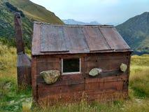 Capanna antiquata della montagna Fotografie Stock
