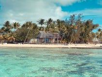 Capanna di legno sulla spiaggia, con un retro effetto Fotografia Stock