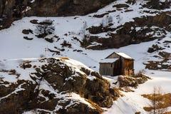 Capanna di legno sulle alpi austriache nell'inverno Fotografia Stock Libera da Diritti